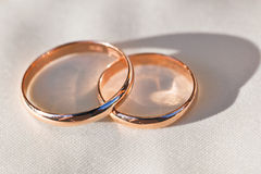 Wedding rings on a background of light fabric Stock Photo