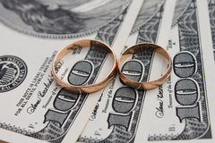 Wedding rings on the background of money.  Stock Photography
