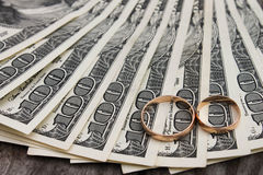 Wedding rings on the background of money Stock Image