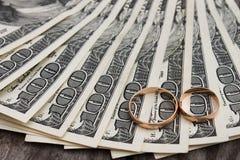Wedding rings on the background of money.  Stock Image