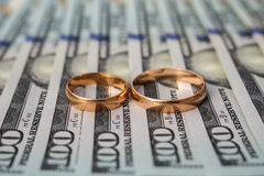 Wedding rings on the background of money Royalty Free Stock Images