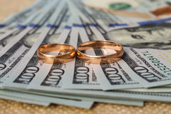 Wedding rings on the background of money Royalty Free Stock Photography