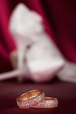 Wedding rings on the background pair of shoes Royalty Free Stock Images