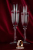 Wedding rings on the background of a pair of wineglass Stock Photo
