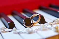 Wedding rings, background piano Stock Photo