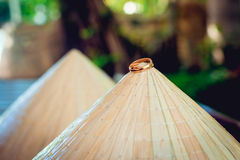 Wedding rings on a background of a vietnam hats Royalty Free Stock Photography