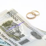 Wedding rings with banknotes Royalty Free Stock Images