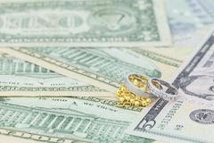 Wedding rings on banknotes background,concept collect money for Stock Image