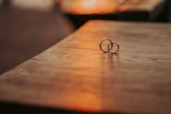 Wedding rings on a beautiful wooden texture surface royalty free stock photo