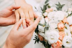 Wedding rings. Being exchanged during ceremony stock image