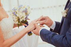 Wedding rings. Being exchanged during ceremony Stock Photography