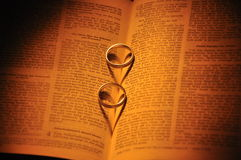 Wedding rings and bible. Wedding rings and a bible Royalty Free Stock Photos