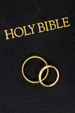 Wedding Rings on Bible Stock Photography