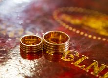 Wedding rings on bible, on church altar. Two wedding rings on bible, on church altar royalty free stock photos