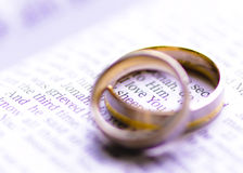 Wedding rings on a Bible with I Love You message Royalty Free Stock Images