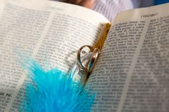 Wedding rings on a bible. Wedding rings in the pages of the Holy Bible. Church of Nazarene Stock Images