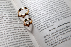 Wedding rings in Bible Royalty Free Stock Image
