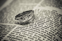 Wedding Rings on Bible. Two wedding rings resting on the Bible Stock Photos