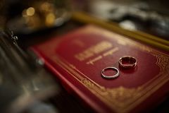 Wedding rings on the bible. Wedding, church Royalty Free Stock Photo