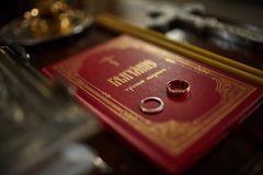 Wedding rings on the bible. Wedding, church Royalty Free Stock Photography