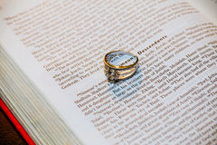 Wedding rings on Bible. Wedding rings, book Stock Photo