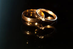 Wedding rings on a black background Stock Image