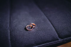 Wedding rings on black fabric Stock Photography