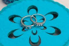 Wedding rings on a blue background Royalty Free Stock Image