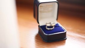 Wedding rings in blue box for the ring. Wedding jewelry stock video footage
