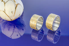 Wedding rings on blue glas Stock Photos