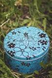 Wedding rings on a blue metal box. Beautiful wedding rings Stock Image
