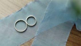 Wedding rings on blue ribbon stock video