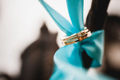 Wedding rings on blue Stock Photos