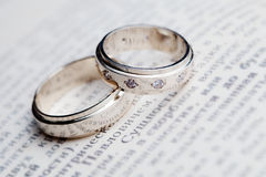 Wedding rings on the book.  Stock Image