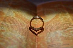 Wedding rings on book. Royalty Free Stock Photos