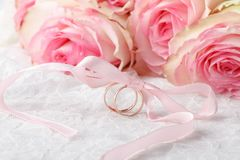 Wedding rings on a wedding bouquet Stock Image