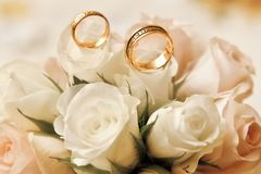 Wedding rings with bouquet Stock Photo