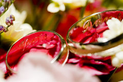 Wedding rings on a bouquet Stock Photo