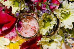Wedding rings on a bouquet stock images