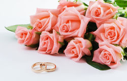 Wedding Rings & Bouquet. Wedding Rings and pink rose bouquet Royalty Free Stock Photography