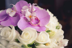 Wedding rings on bouquet. Wedding rings on wedding bouquet Stock Photos