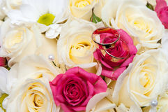 Wedding rings on the bouquet Stock Photography