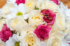 Wedding rings on the bouquet. Royalty Free Stock Photo