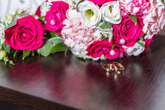 Wedding rings. With bouquet and accessories Royalty Free Stock Images