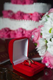 Wedding rings. With bouquet and accessories Stock Photos