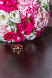 Wedding rings. With bouquet and accessories Royalty Free Stock Photography