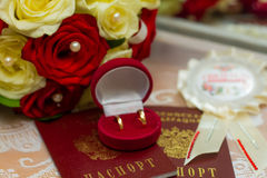 Wedding rings. With bouquet and accessories Stock Images
