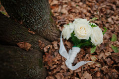 Wedding rings with bouquet. At autumn leaves Royalty Free Stock Photo