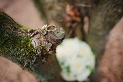 Wedding rings with bouquet Stock Photography