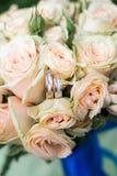 Wedding rings on wedding bouquet. Beautiful wedding rings on wedding bouquet outdoors Stock Photography